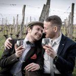 two men in love drinking wine