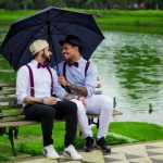 Two gay man in love sitting on a bench