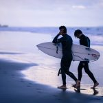gay couple surfing